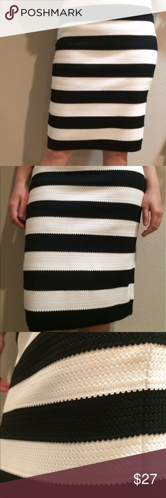Express body con skirt Express body con striped black and white. In good condition. No zipper. Skirts Pencil