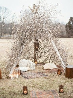 bohemian teepee wildflower wedding lounge area - photo by Lauren Fair Photography