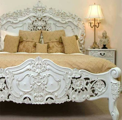 a fabulously rococo bed styled with pale toffee hued linens in a white room omg i absolutely love this bed for my vintage french themed room