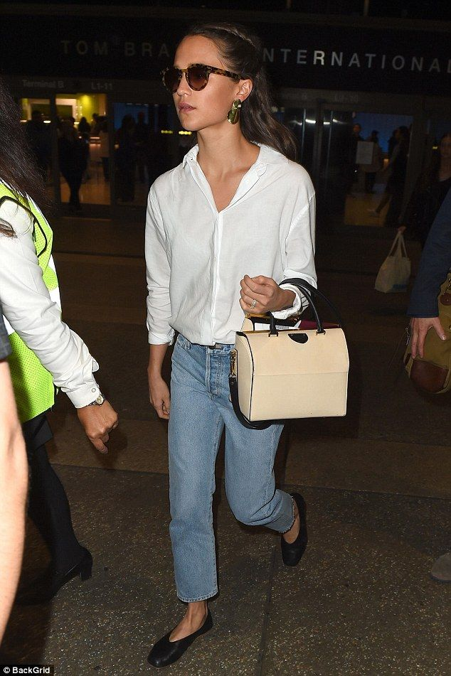 0324775c9379 Alicia Vikander is classically chic in crisp white shirt and shades ...