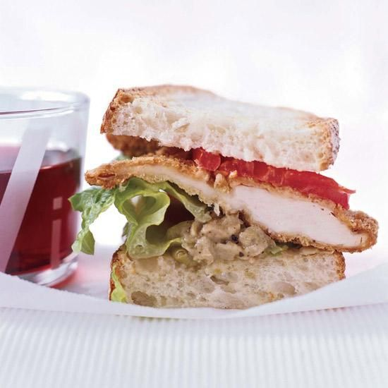 Crispy Fried Chicken Sandwiches | Chef John Hennigan says the idea for this chicken sandwich came from a small deli in New York City. Hennigan substitutes a creamy truffled artichoke tapenade for the mayonnaise used in the Lenny's version.