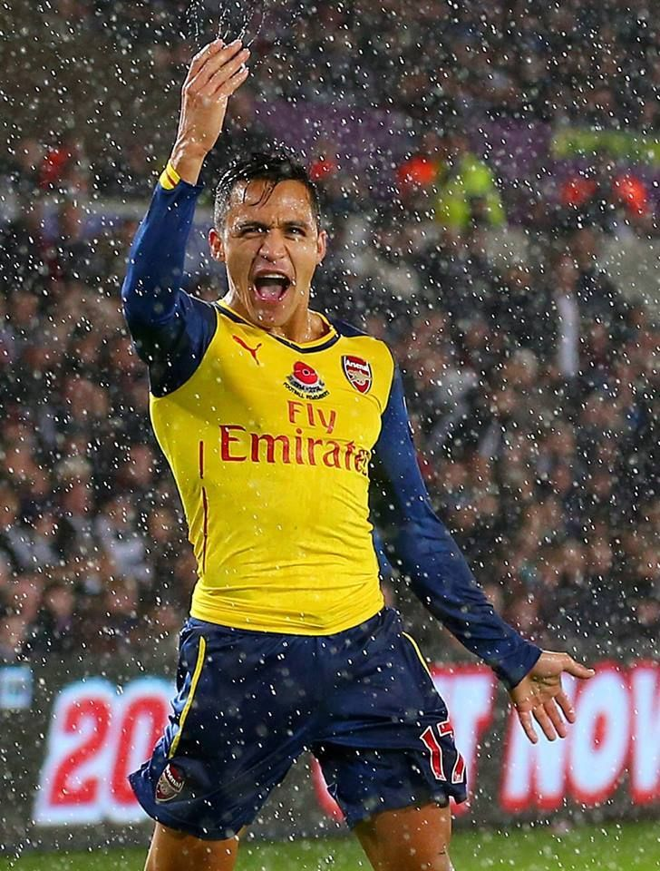 Happiness is #Alexis playing #football in the rain. http://ozsportsreviews.com/2014/09/arsenals-busy-transfer-window/