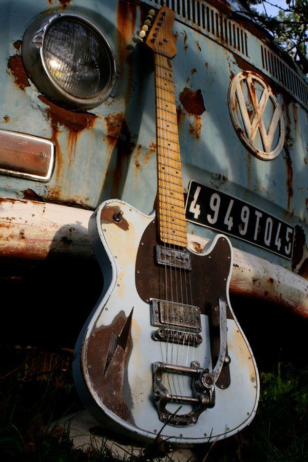 VW bus and guitar; one needs a tune-up, the other needs to be tuned...guess it's too late for both!