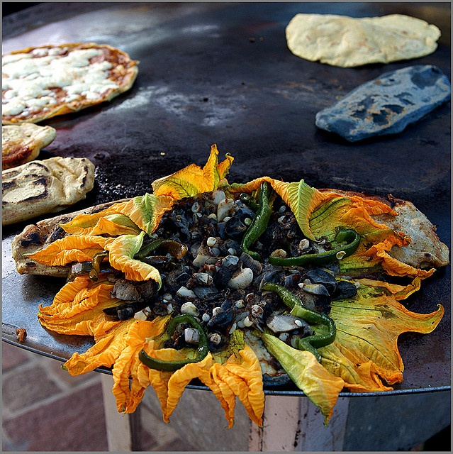 Flores de calabaza con huitlacoche (squash flowers with huitlacoche) I'd like a quesadilla, please.