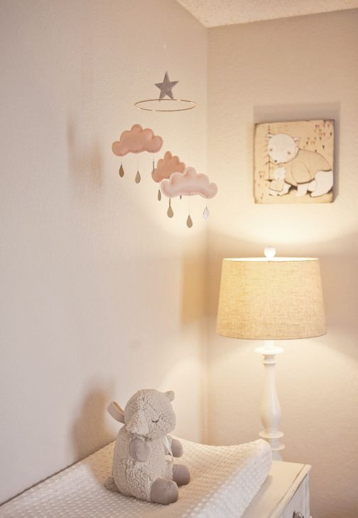 "Kelli says that the felt cloud mobile is one of her favorite pieces in the nursery, and the ""Mama Bear, Baby Bear"" painting is a Kelli Murray original!"