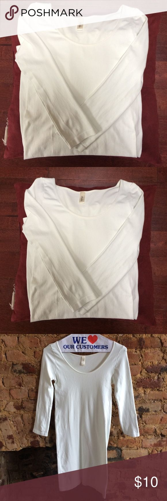 Classic white and tight shirt dress White shirt dress. One size but on the tighter side. 92% Nylon and 8% Spandex. Made in USA. Handwash cold. White is an off-white. NikiBiki Dresses Long Sleeve