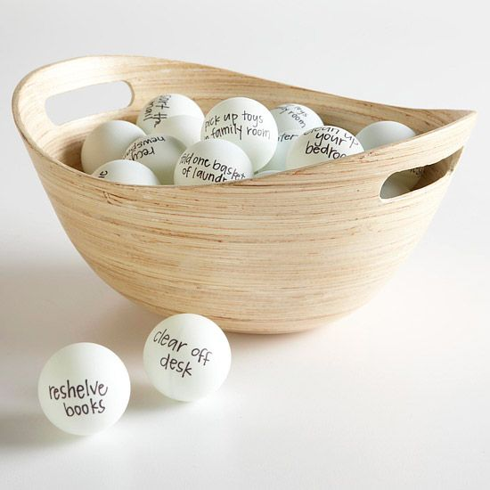 Love this!!!!!  Clutter Busting Game using ping pong balls-Each person chooses a ball, completes the task, then chooses another one. After 30 minutes, whoever has the most balls gets a prize -- like a no-chores day, or gets to pick a movie. Such a great idea!
