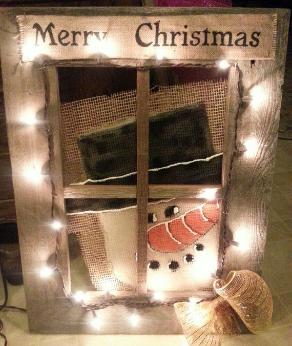 Barn wood window with a hand painted snowman on burlap peeking through the window. High lighted with gold mesh bow and burlap Merry Christmas