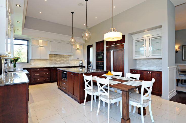 Kitchen renovation- custom upper cabinets, custom butcher block table, new lighting and backsplash
