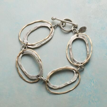 LINKOLOGY BRACELET - The classic chain link bracelet redefined with ovals within ovals of hammered sterling silver and 14kt gold filled, all fastened by a handcrafted sterling toggle.