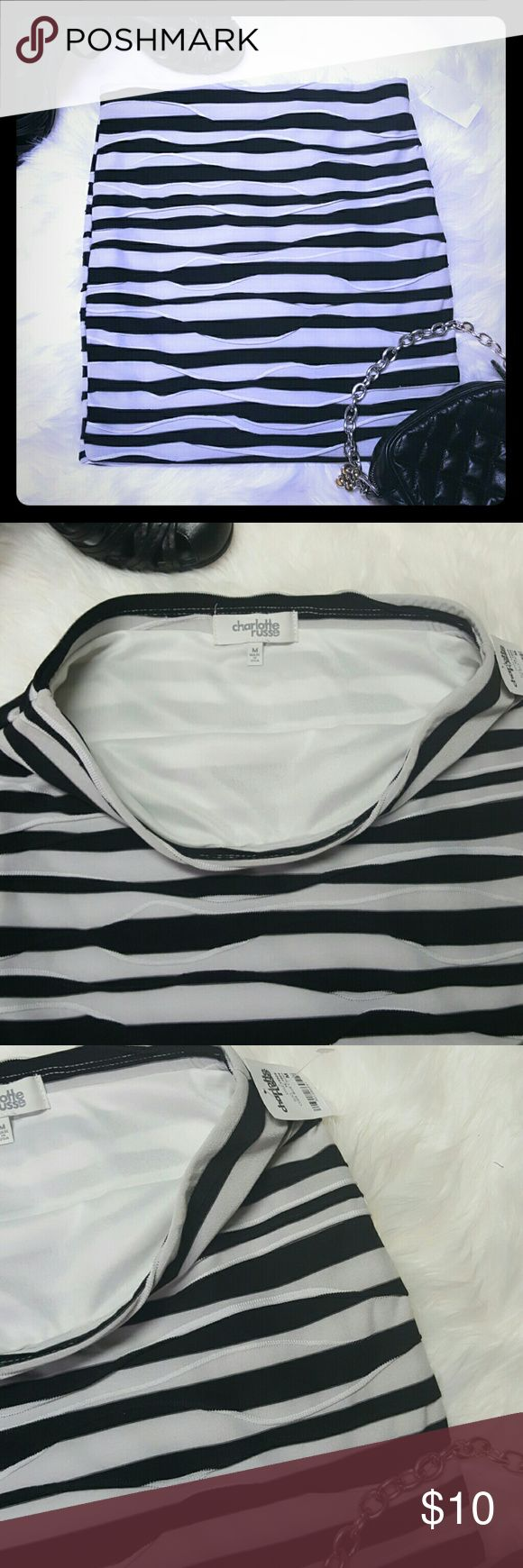 Charlotte Russe black and white body con skirt Fully lined. NWT. Size Medium. Has a wavy stitch design, bandage body con fit and look. Elastic waist. Charlotte Russe Skirts Mini