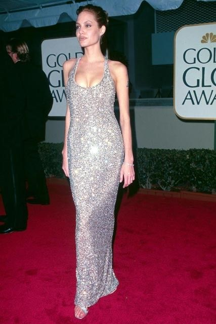 65 Best Golden Globe dresses of all time - ANGELINA JOLIE - Back in 1998, a young Ange gave us a hint of what was to come, stepping out in this ultra-glam sparkling gown. (1998)