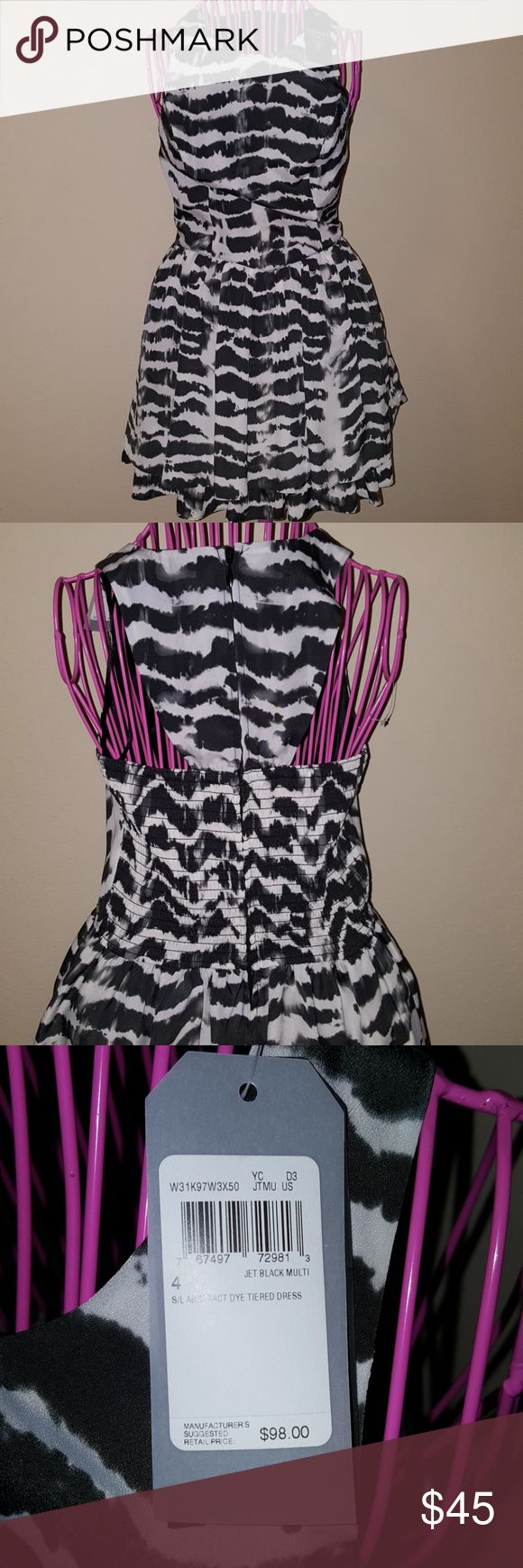 Guess dress Lovely black white and gray dress. Zipper in the back flowing bottom just perfect for holiday parties Guess Dresses