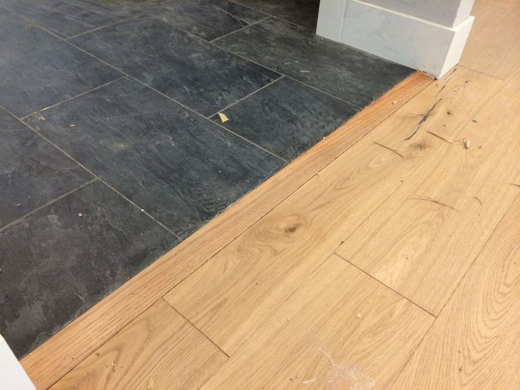 100 to install this transition piece between the slate for Wood floor pieces