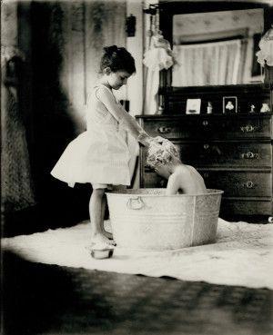 The Saturday Bath. Young girl giving boy a shampoo in a washtub, 1909. Missouri History Museum