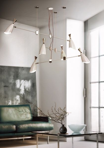 Like this chandelier, but not sure that something like this would have enough presence in home. Also could be too modern.
