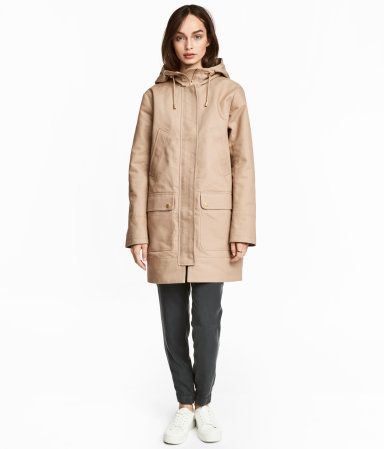 Beige. Parka in thick cotton fabric. Drawstring hood with adjustable tab. Flap at front with zip and concealed snap fasteners, diagonal handwarmer pockets,