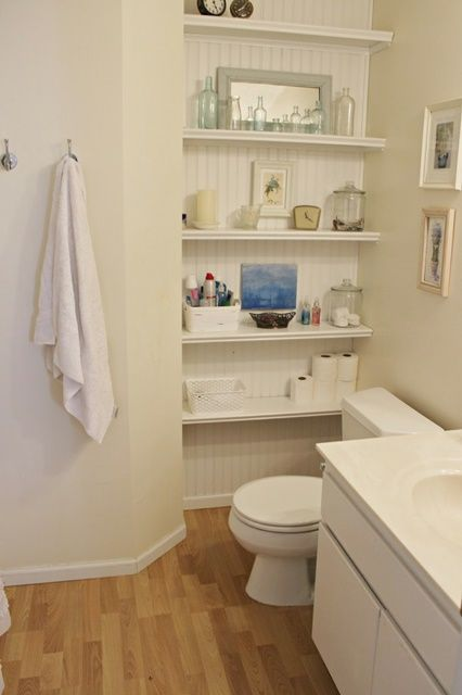 Cottage Style Bathroom - great use of alcove to create storage!