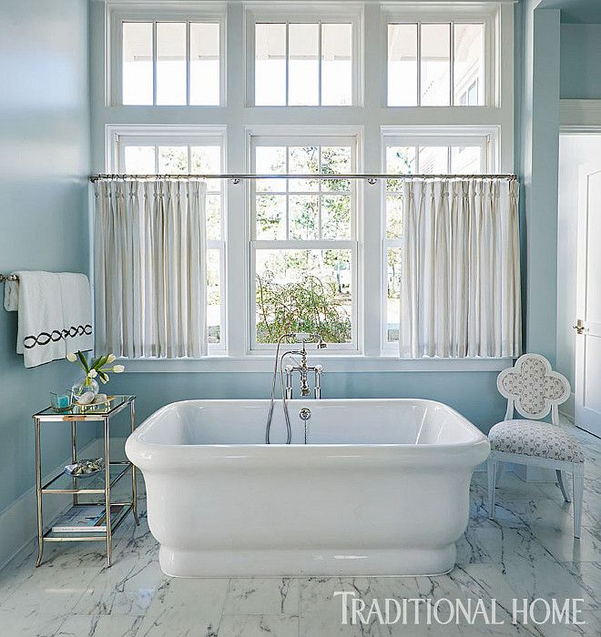 """Farrow and Ball 235 Borrowed Light"". The polished nickel étagère and soaking tub are from Waterworks."