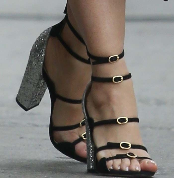 Salma Hayek gets her hands on the unreleased glitter runway shoe from Giambattista Valli's latest collection