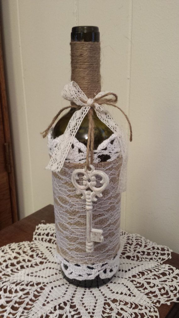 Going to do this one. Rustic Wine Bottle Vase with burlap lace