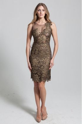 Gold coated lace with black sheer cut outs. The Fleur dress is made from a black sheer mesh and is embellished with gold lace cut outs. It has a one shoulder illusion created by the lace and is designed as a slim fit. The detailed hemline gives this dress a fun yet elegant look. #evening #gold #goldfloralpattern #goldfloralpatterndress #golddetail #meshdetail #detailed #detaileddress #elegant #kneelength #NARCES