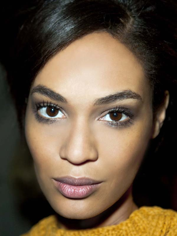 Joan Smalls' full eyebrows: http://beautyeditor.ca/2012/08/20/why-my-new-brow-grooming-regimen-no-longer-includes-thread-or-wax/