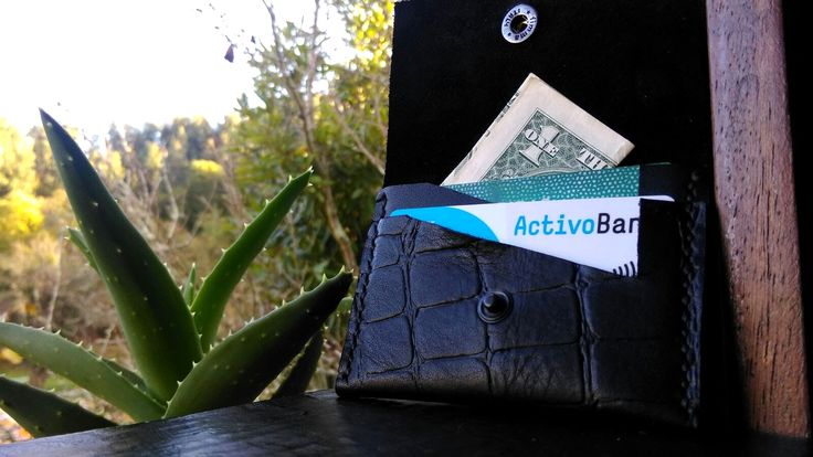 This is a smaller wallet for those times that you don't want to carry a larger wallet with you and perfect for small bags. Black Croco leather. Unique creation made in portugal