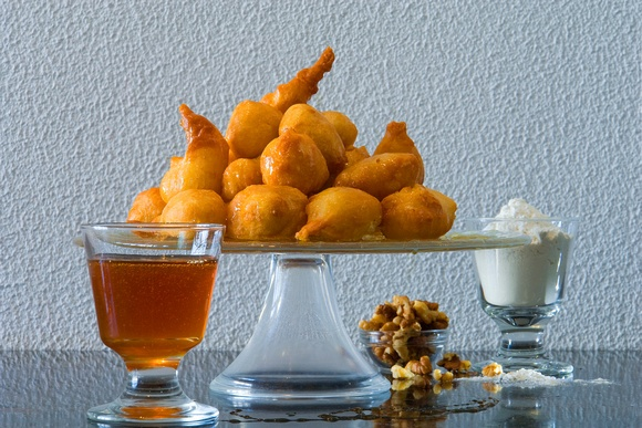 """ Loukoumades "" , greek doughnuts with honey, yoghurt and walnuts"