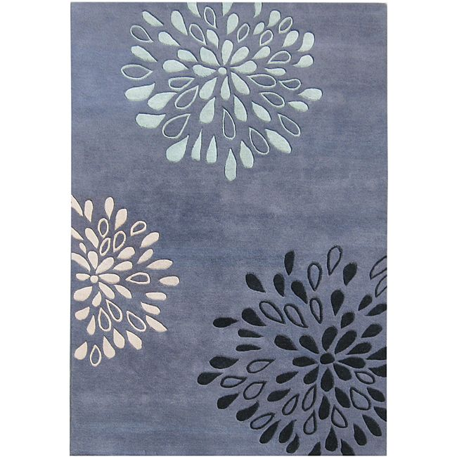 Hand-tufted out of a lush New Zealand wool-blend, this rug features a striking floral design that will add a contemporary look to your living space. This rug also features a vivid moon light blue, steel grey, and turquoise color scheme.