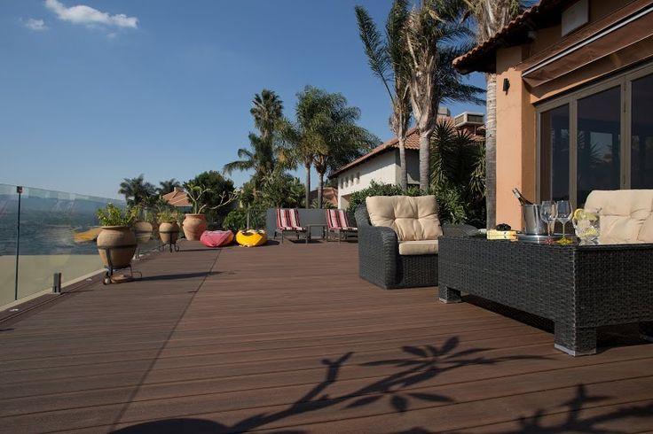 Residential project at Peaconwood Estate by Eva-Last using Eva-tech Infinity #decking, Zambezi Kiaat finish.