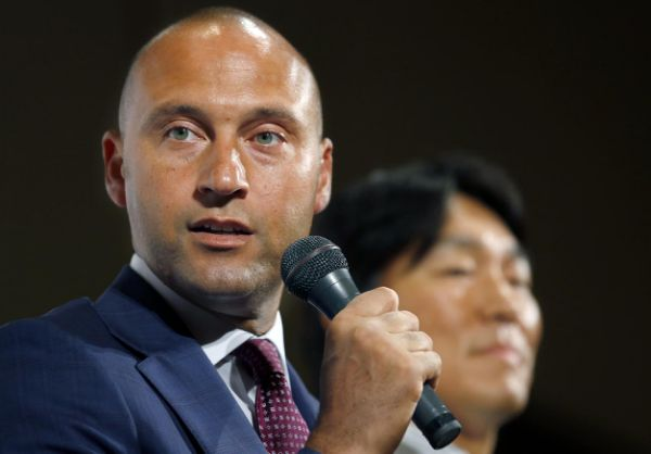 Derek Jeter says he never handed out gift baskets of memorabilia to women who spent the night at his house.