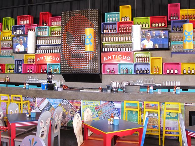 This place is so colorful! I love the sugar skull & mexican fighter chairs ^_^ // Santos Diablitos | interiorism by Henriquez Lara Studio