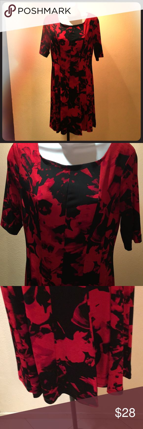 Floral print dress size 8 connected apparel. Cute red and black floral dress. Scooped neckline, short sleeves. Bust 34, waist 28, hips 38, length 37 1/3, sleeve length 14. (All measurement are taken and doubled. New without tags. connected apparel Dresses