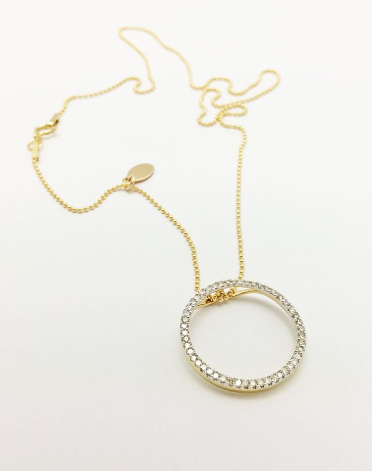 14K Gold and Diamond Circle Pendant on Ball Chain with a logo tag. All parts sold available at Gempacked.com