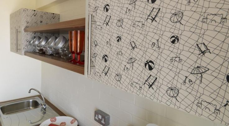 In Boscombe (UK) each beach pod includes a kitchen with exclusively designed 'fish' or 'beach' illustrations by Hemingway Design using specially produced Younique® by Formica Group laminate on the kitchen cupboards