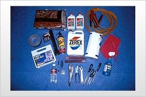 ROADSIDE EMERGENCY KIT:   Jumper cables   Flares  Oil  Antifreeze  First aid kit   Blanket  Extra fuses  Flashlight/extra batteries  Screwdrivers  Pliers  Vise Grips  Adjustable wrench  Tire inflator (such as a Fix-A-Flat)   Tire pressure gauge  Rags  Paper towels  Duct tape  Spray bottle with washer fluid  Pocketknife  Ice scraper  Pen/paper  Help sign  Granola or energy bars  Bottled water  and heavy-duty nylon bag to carry it all in.