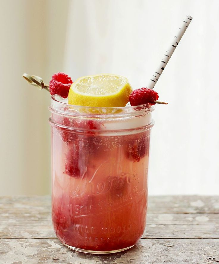 Smashed Raspberry Lemonade Cocktail, Serves One   2 ounces Triple Sec 2 ounces Limoncello 1 handful of raspberries  juice of two lemons club soda  raw sugar