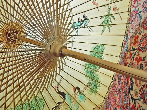Enormous vintage rice paper and bamboo parasol with double struts of bamboo.  I imagine a roof made like this.