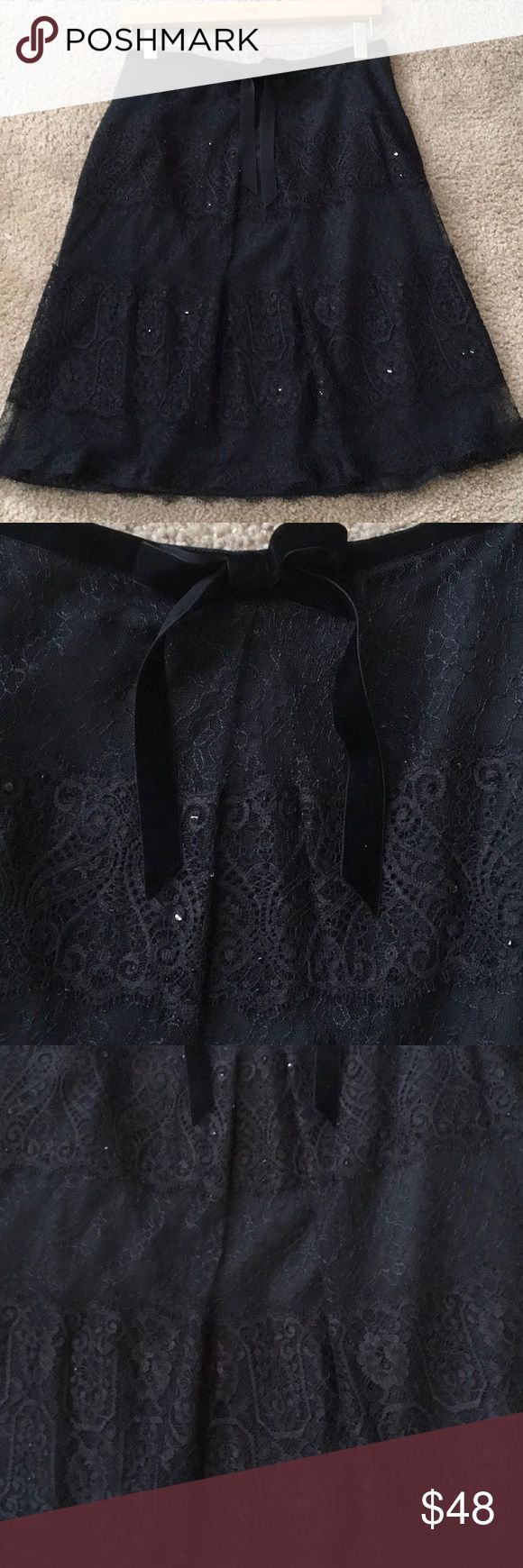 """ANN TAYLOR LACEY BLACK Sequin LINED SKIRT 8P NEW Feminine sophisticated black dressy lace skirt scattered w black sequins....Different lace designs so PRETTY. side zip, waistline w/ black velvet ribbon, bow in center, fully lined Sz 8P...29"""" fully around waist zipped. 21"""" waist - edge of lace. NEW PERFECTION 🔆🖤🔆🖤🔆🖤 Ann Taylor Skirts"""