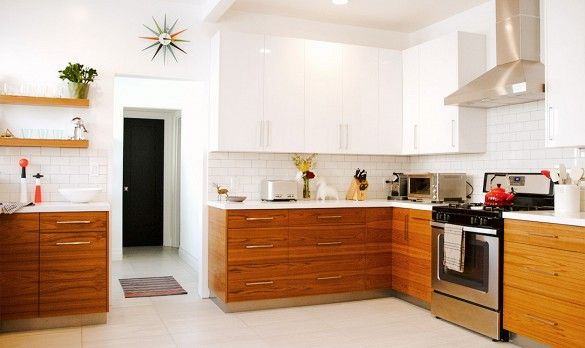 Beautiful contrast between these white and wooden cabinets. The look is so clean and sleek.