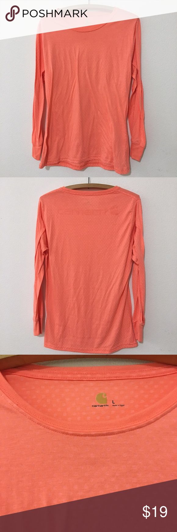 """Carhartt Polka Dot Long Sleeve Shirt Carhartt Polka Dot Long Sleeve Shirt. Peach color. A little brighter and lighter color than pic is showing. Polka dots are mini Carhartt symbols. Logo on back. Super soft.   Size: Large About 26.5"""" length (top shoulder hem to bottom)   Good preloved condition. Barely worn  Bundle fav items for a personal discount. Offers are always welcome, too! No trades or modeling. Thank you! (3) Carhartt Tops Tees - Long Sleeve"""