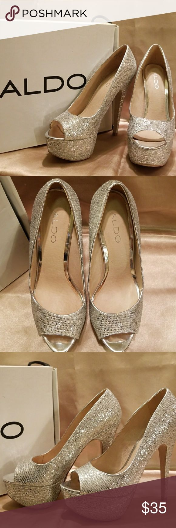 """Aldo Berthina Silver Peep Toe heels (7.5) Stunning Silver Glitter peep-toe 5"""" heels. Worn out twice and in great condition. Has normal wear and if you look up close you can see some glitter has rubbed off. Beautiful shoes I hate to sell that are boxed and taking up space in my closet. Waiting for someone else to love and enjoy them. ❤👠 Aldo Shoes Heels"""