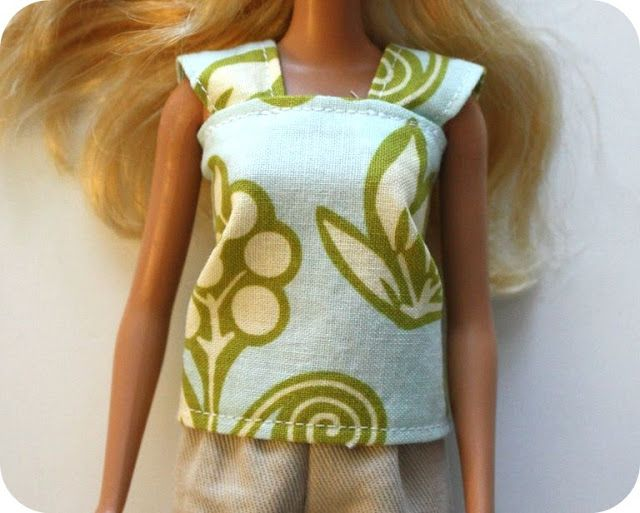 http://www.craftinessisnotoptional.com/2010/09/barbie-cap-sleeve-shirt-tutorial.html