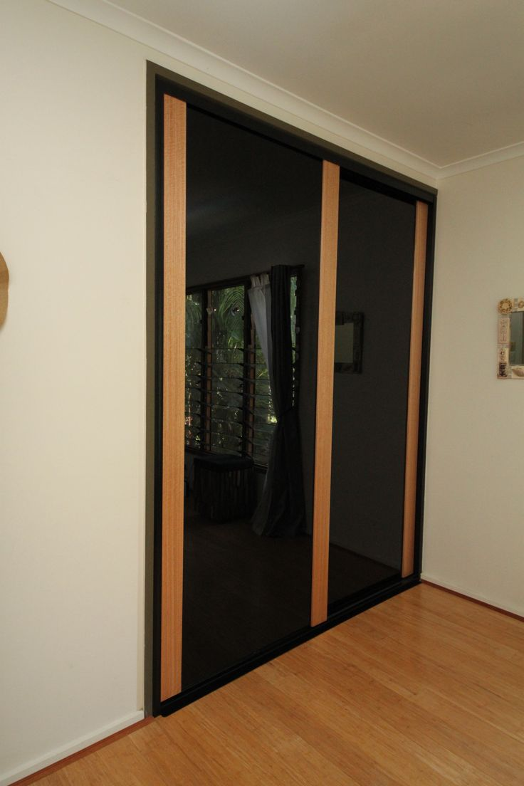 WOW,  Infinity Sliding Doors using Black glass and Tassie Oak Timber.  Form Function NT