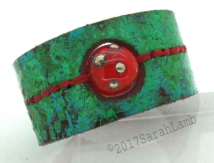 leather cuff with glass lampwork bead by sarahclamb on Etsy