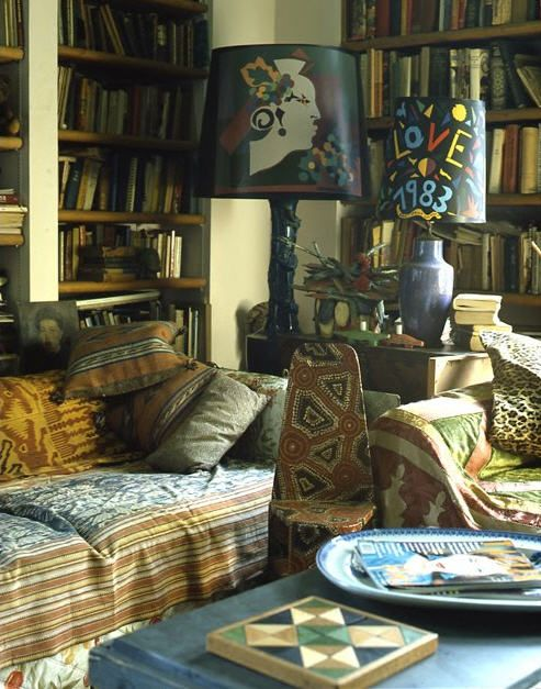 Corner of Maxime de la Falaise's NYC apartment which she sold in the 1990's. Books everywhere, mixed fabrics, surfaces covered completely (two lamps with graphic lampshades on a small, crowded surface. But it works.  *Maybe a little too crowded for me but it looks homey