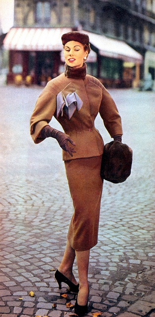 Stella in wool suit with fur collar, and fur hat and muff by Jacques Fath, 1953