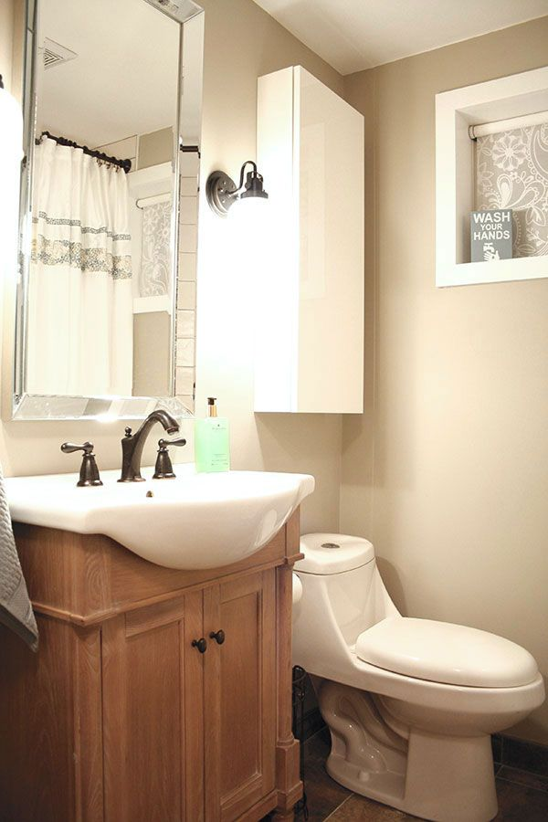 This small basement bathroom needed a design that added both space and storage.  Without compromising on style, the narrow depth of this vanity gave the space required and the wall cabinet provided the much needed storage.