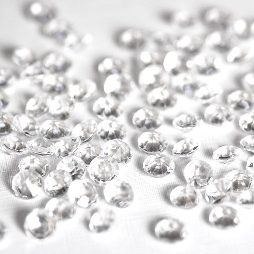Clear Diamond Confetti To Sprinkle (comes in Topaz too). $10 for 2,000